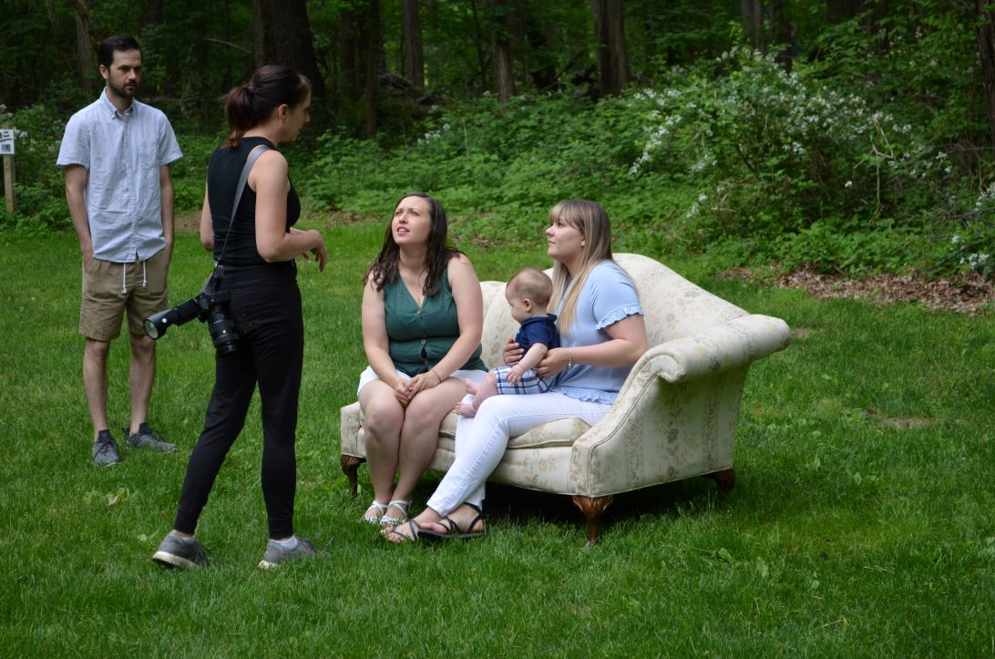 Karen is our photographer and also an adoptive parent talking to a birth mom and adoptive mom on the sofa about adopting a baby in Ohio